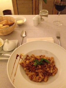 Tasty Italian tagliatelle Bolognese  with Tunisian wine